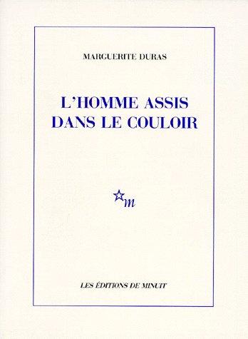L HOMME ASSIS DANS LE COULOIR